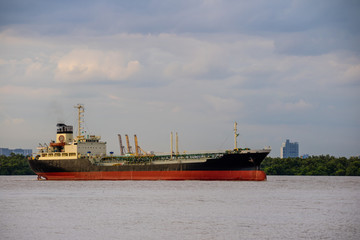 Logistics and shipping transportation of Oil gas tanker ship, international import export cargo vessel on ocean or river in evening