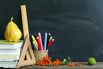 School supplies with empty blackboard background concept