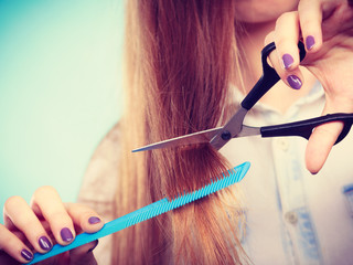 Prepared girl to cut her long straight hair.