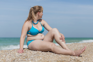Overweight blond at the sea