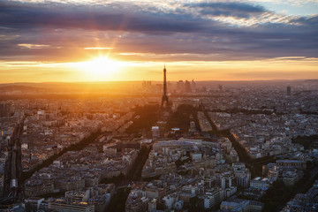 Spectacular view of Paris, France, from the Tour Montparnasse with the Eiffel Tower at sunset. Beautiful skyline. Travel background.