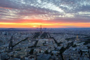 Scenic aerial view of Paris, France, from the Tour Montparnasse with the Eiffel Tower in the background. Colourful nighttime skyline. Travel background.