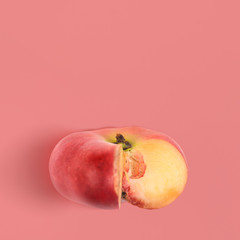 Fresh saturn peach on pink background, view from above