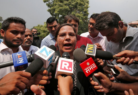 Farha Faiz, a lawyer, speaks with the media after a verdict for the controversial Muslim quick divorce law outside the Supreme Court in New Delhi