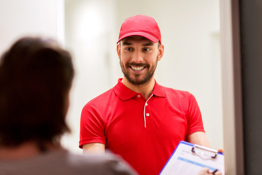 deliveryman with clipboard at customer home