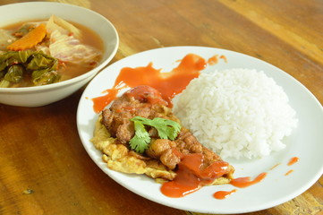 fried egg dressing chili sauce on rice eat with Thai mixed vegetable curry sweet and sour soup