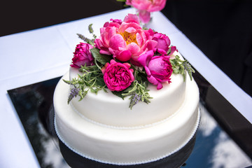 Wedding Cake Layered with roses and peony