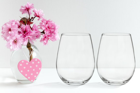 Mockup - stemless wine glasses, blossom in a vase, perfect for businesses who sell decals and stickers, just overlay your designs