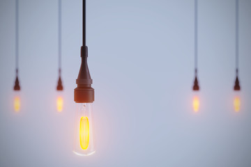 3D Rendering Of Thin Light Bulbs Hanging On Cable On Blue Background