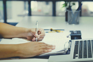 business writing on paper in office with vintage tone.