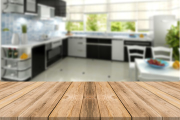 Empty light wood table top with kitchen  background. Leave space for placement you background - can be used for display or montage or mock up your products.