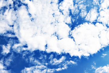 White fluffy clouds in a clear blue sky