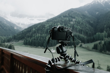 Digital camera on flexible portable tripod taking a landscape picture
