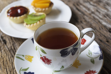 A cup of tea and small tarts