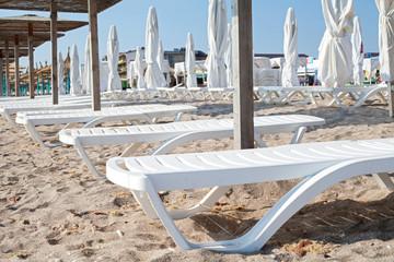 Sunbeds and umbrellas on the romanian seaside