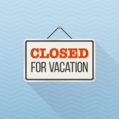 Simple white sign with text 'Closed for vacation' hanging on a blue office wall. Creative business interior template for shop, store, supermarket. Rectangular layout for holiday season.