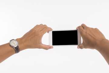 Isolated image of hands holding mobile phone and taking photo on white background