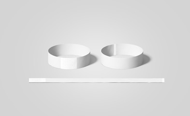 Blank white paper wristbands mock ups, front and back side view, 3d rendering. Empty event wrist bands design mockup. Cheap hand bracelets template, isolated. Clear concert bangle wristlet set.