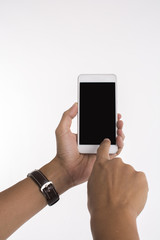 Isolated image of hands holding mobile phone and touching screen on white background