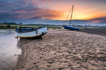Boats on the Aln Estuary at Sunset / As the River Aln approaches the North Sea at Alnmouth, now tidal, there are several boats moored in the estuary