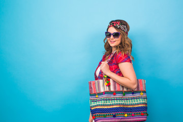 young woman in hippie style posing at studio. Fashionable photo.