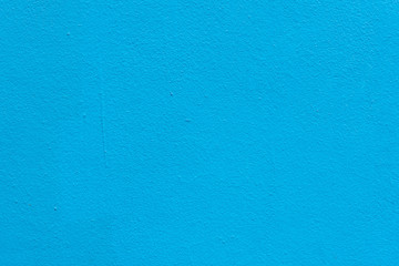 Background of Cement wall painted bright blue and rough.