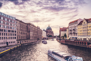beautiful spree river with boats and berlin dom in the background
