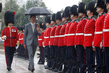 Canada's PM Trudeau inspects the honour guard during a ceremony in Ottawa