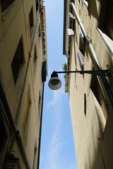 The narrow alleys of Venice have street lights placed on the buildings