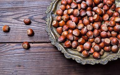 Hazelnuts on an iron plate