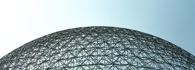 Dome shape structure with a blue and gray sky Wall mural