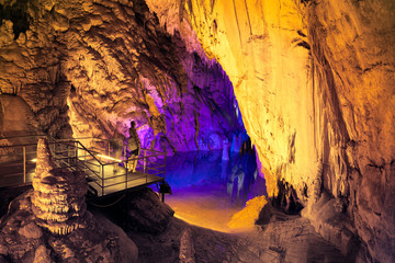 People admire the beauty of underground lake in Dim cave. Valley of Dim river, Alanya, Turkey