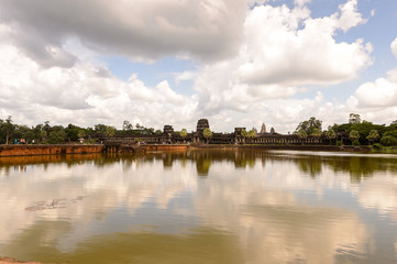 Angkor Wat (Temple City) and its reflection, a Hindu, then a Buddhist, temple complex in Cambodia and the largest religious monument in the world.