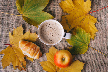cappuccino and autumn leaves . autumn concept,flat lay