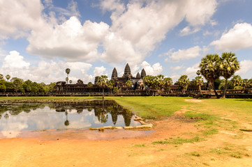 Angkor Wat (Temple City) and its reflection in the lake, a Buddhist, temple complex in Cambodia and the largest religious monument in the world. View from the garden