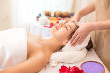 Attractive young and healthy Woman in spa salon is having massage, Spa, health and healing. Woman with Head Massage Concept.