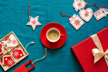 Preparing for Christmas. Red objects on turquoise background. Space for copy. Top view