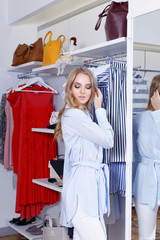 Beautiful blonde on a shopping in a boutique