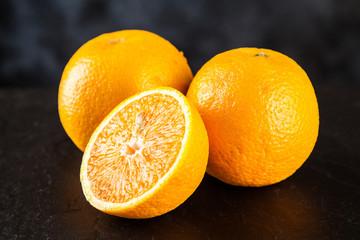 Fresh oranges on dark background