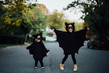 two children dressed as bats for halloween