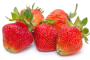 Ripe strawberry with beds on white