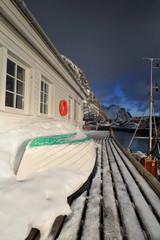 Small fishing boats ashore upon wooden pier-harbor's W.side. Hamnoy-Reine-Lofoten-Norway. 0244