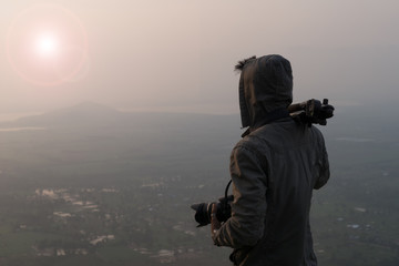 Man photographer asia and camera on mountain at sunrise. Travel Lifestyle hobby concept adventure active vacations outdoor