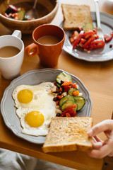 In the morning Breakfast is two eggs, toast, salad and coffee.