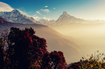 Spring season in Nepal with view of Fish Tail mountain with early morning sun rays in Gandaki Zone Nepal in retro styled.