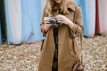 Close Up Of Fashionable Woman Holding Analog Camera