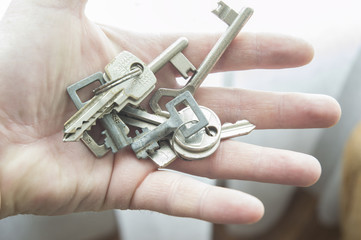 Man's hand with lot's of keys