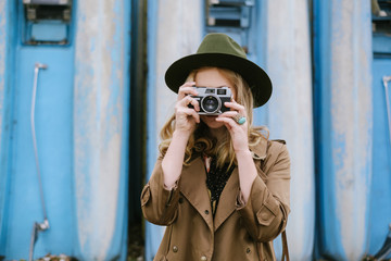 Fashionable Woman Taking Pictures With Analog Camera