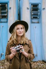 Beautiful Blond Woman Holding Analog Camera