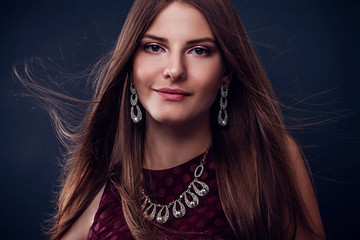 Beautiful woman with long hair wearing jewellery